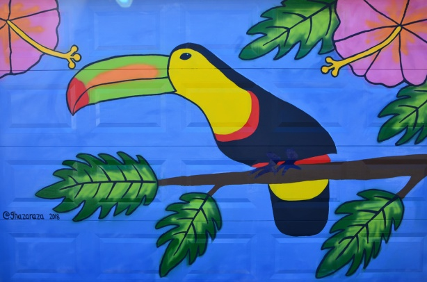 mural of a toucan on a garage door