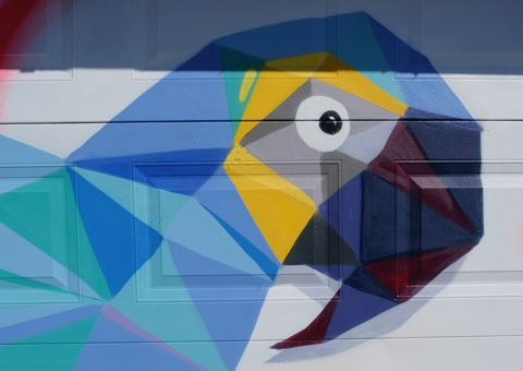 parrot head on a garage door, mural, done in triangles and other straight edged shapes
