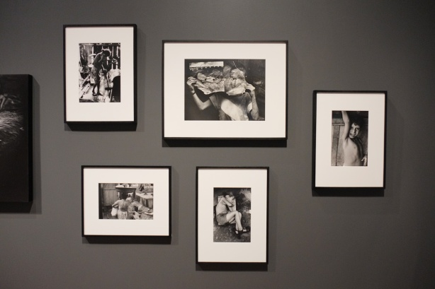 five black and white photos on a dark grey wall, photos by Gordon Parks of poverty in Rio de Janeiro in the 1960s