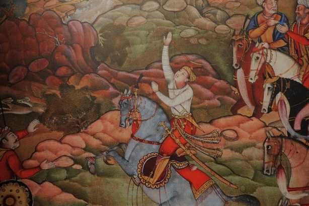 part of a painting at the Aga Khan museum of a moghul ruler on a horse in a hunting scene