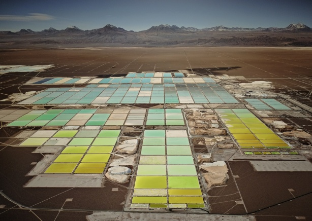 coloured ponds in a lithium mine in Chile, shades of yellows, greens and blues