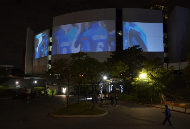 large projections on the concrete wall of Scarborough Civic Center