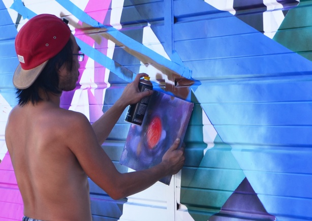 spray painting a mural