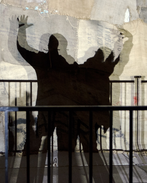making shadows against the fabric draped around City Hall and Nathan Phillips square