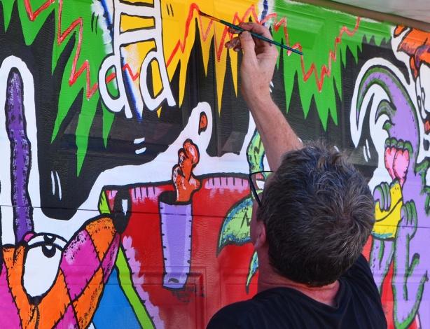 Runt, street artist, painting a mural