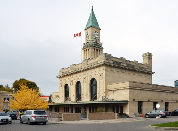 view of front of Summerhill LCBO store, former CP train station, olf light brown stone building.