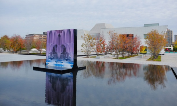 a painting called The Encompassing stands in a reflecting pool in front of the Aga Khan Museum.