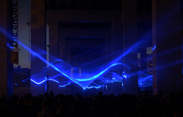 blue lights under the Gardiner at the Bentway, in front of Fort York, a light show called Waterlicht by Dutch artist Daan Roosegaarde