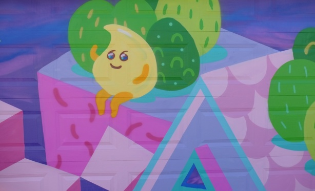 lemon drop character on a pink and purple house with green trees, a mural by Jieun June Kim