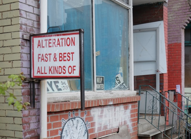sign on an old house, now a commercial property, that says Alteration Fast & Best All Kinds Of