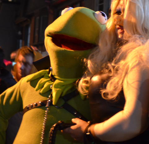 two people in costume, one as a life sized Kermit the Frog and the other as Miss Piggy, both from The Muppets