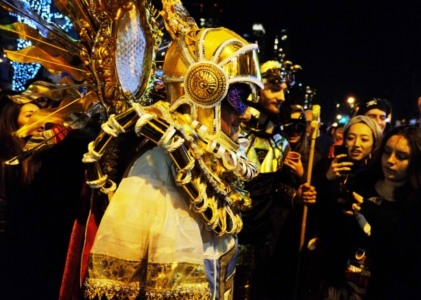 a man in an elaborate gold embellished old fashioned scuba diving mask with glittery gold coloured rays emanating from it