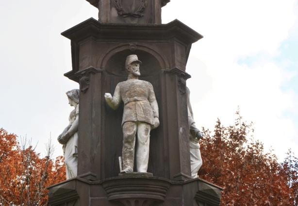 close up of statues on monument - soldier with missing arm, from the 1800s,