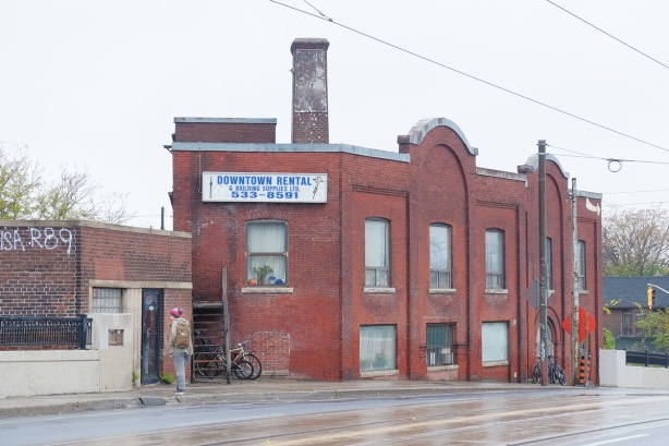 old red brick building on Dundas West, sign that says Downtown Rental