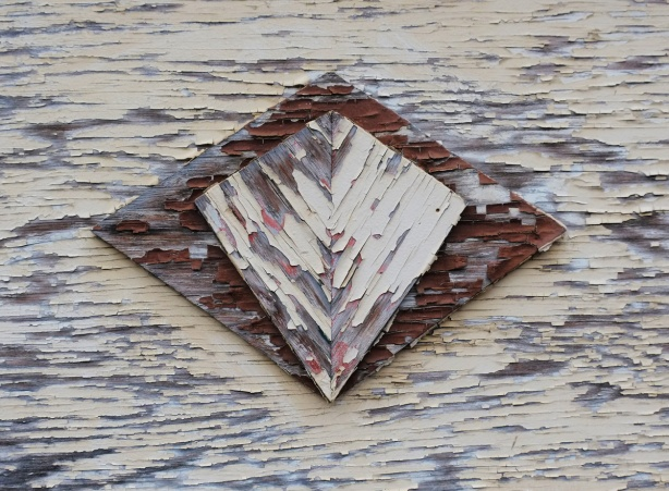paint peeling on wood, three layers of wood with upper two layers cut in diamond shapes