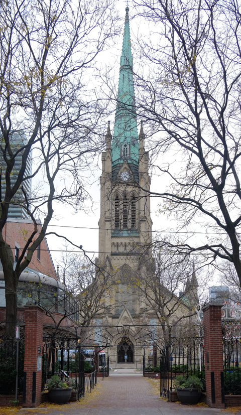 St. James Cathedral and steeple from across the street, shows whole of front of the church, in early winter so the trees in front have no leaves