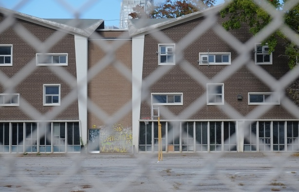 back of part of Davisville public school through chainlink fence, before demolition