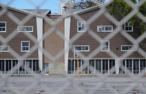 back of part of Davisville public school through chainlink fence, before demolition