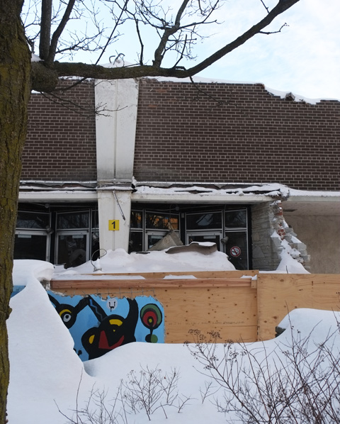 old front entrance of Davisville public school, lots of snow, broken walls as it is in the proces sof being demolished.