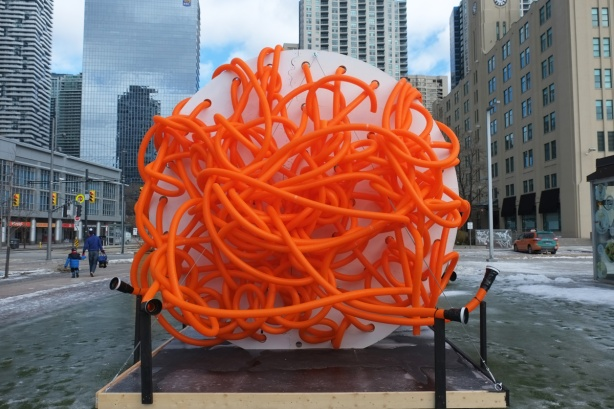 Connectors, a large art installation consisting of bright orange plastic tubes are jumbled up together