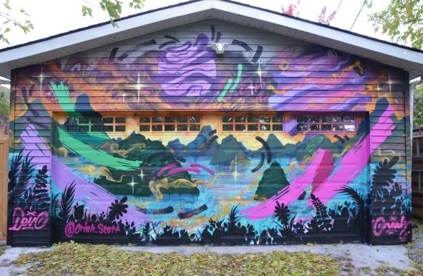mural on a garage door in Feel Good Lane by Oriah Scott