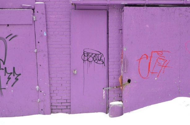 purple garage with purple door, snow in front
