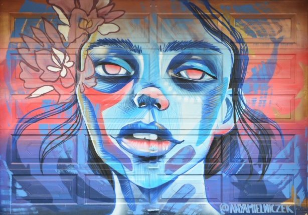a mural of a woman's face by Anya Mielniczek