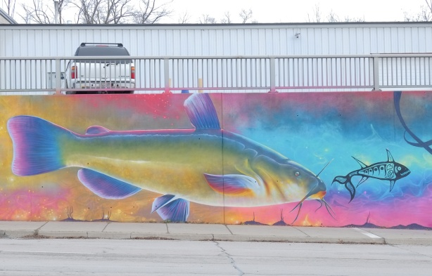 part of a Nick Sweetman mural on 30th street, a yellowish fish with blue fins