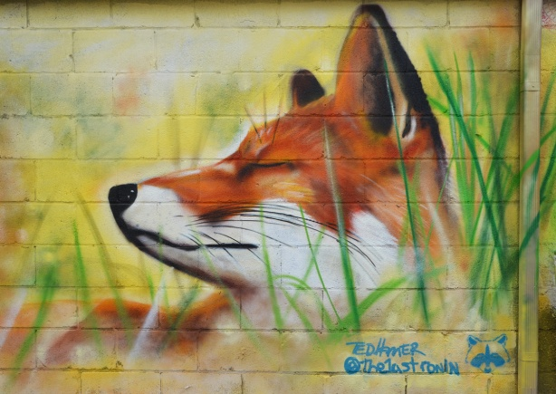 street art painting of a fox head in profile by Ed Hamer, realistic