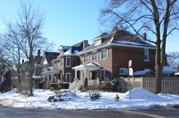 large two stroey brick houses, winter, street,