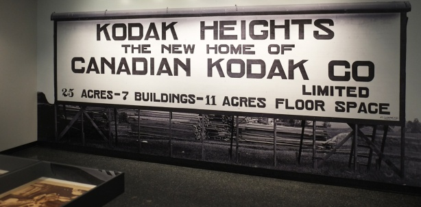 photo of a large billboard advertising the new home of Kodak in Kodak Heights, Keele Street, Toronto, back when it was being built.