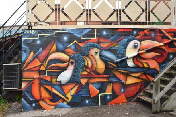 colourful abstract mural of three birds