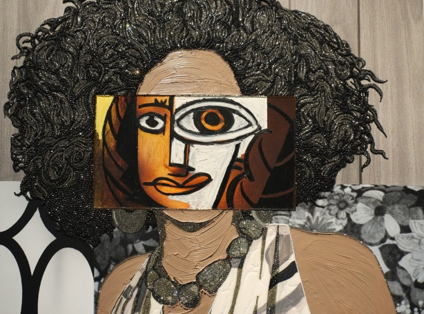 a portrait of a black woman by Micklene Thomas where the face has been done in a Picasso-like style