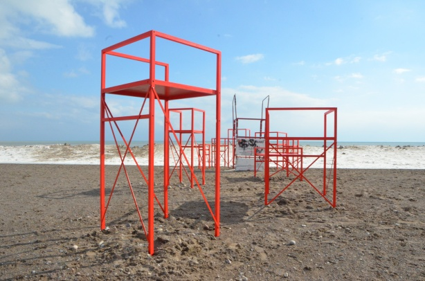 red metal chairs that look like lifeguard stations, part of Winter Stations 2019 at Woodbine Beach,