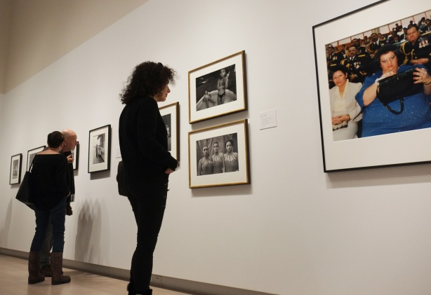 people looking at framed photographs being exhibited at Ryerson Image Centre
