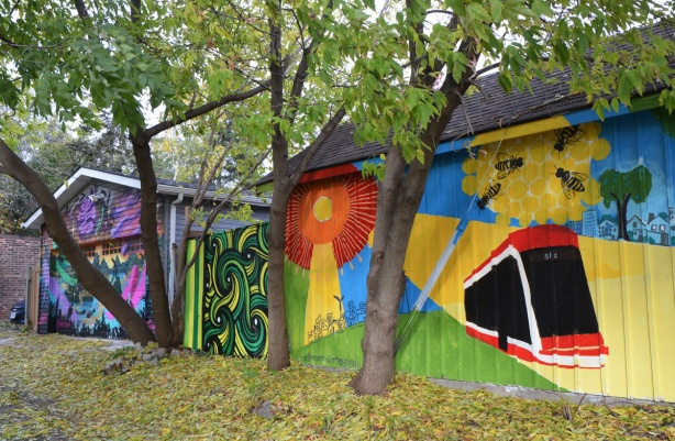 behind trees, in the autumn, murals on the sides of garages, TTC streetcar, orange flower, green abstract,