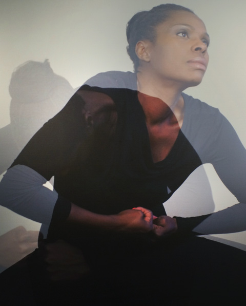 part of a photo by Stella Fakiyesi of a black woman, two images superimposed on one another