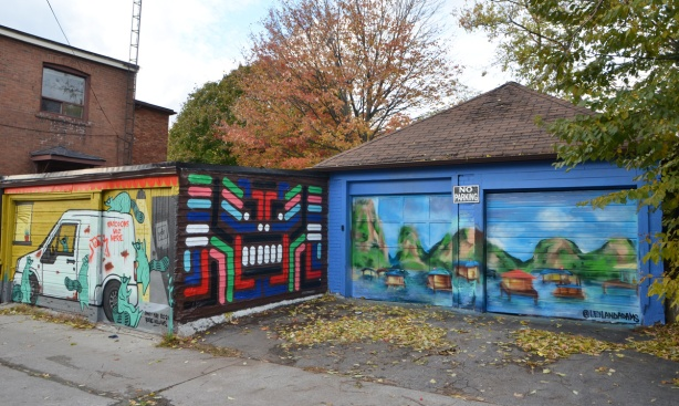 3 murals in Feel Good Lane, one abstract rectangles and bars of colour, one a realistic painting,