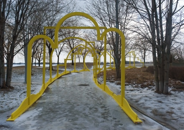 yellow arches over an ice covered path, art installation ice breakers, on Toronto waterfront,