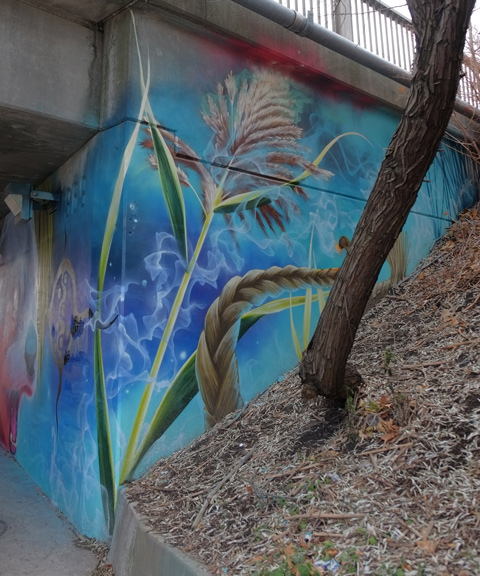 part of a Nick Sweetman mural on 30th street - plants, with a real tree growing in front of it