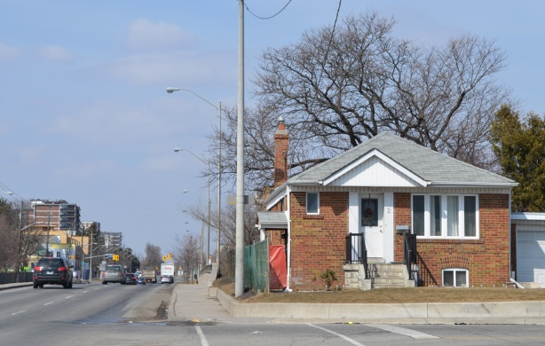 a small bungalow on a side street that faces the main road, Victoria Park Ave