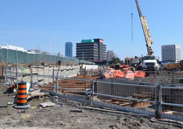 underground sections of LRT being constructed at Don Mills and Eglinton, crane at work, metal frame over tunnel