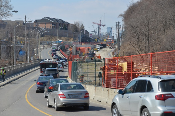 traffic drives west along Eglinton Ave., up the hill from Leslie, through the crosstown LRT construction