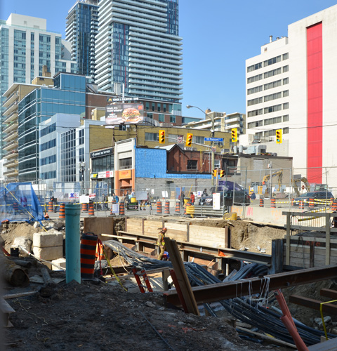 holes in the ground on construction sites on Eglinton Ave for the new crosstown LRT