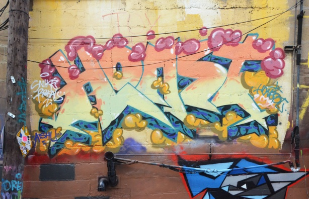 a text graffiti by horst, yellows and pale pinks
