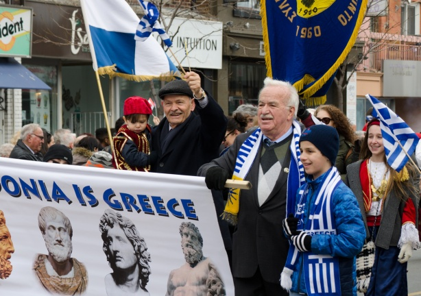 a group of people, older men with kids, Greek Independence day parade