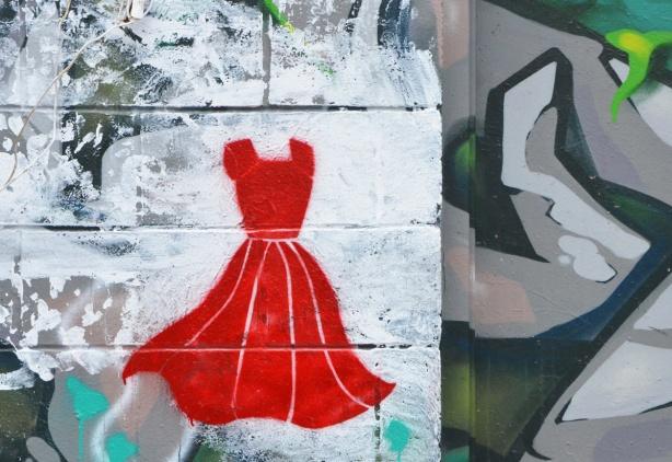 little graffiti stencil, a red dress on a white background
