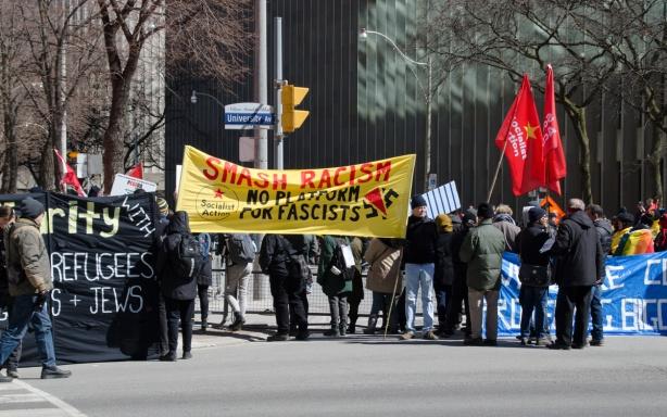 smash racists says a yellow banner