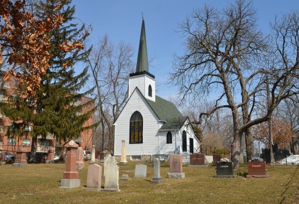 a small white church in a cemetery, St. Juds Anglican church built in 1848