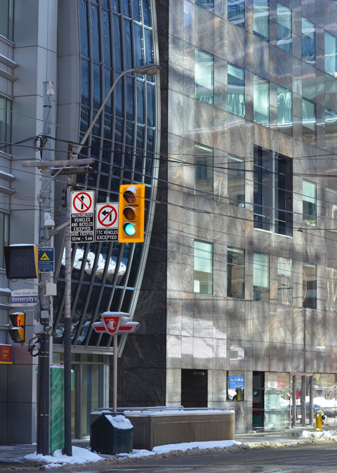 buildings on the southwest corner of University Ave and King Street, traffic lights, entrance to St. Andrew subway station